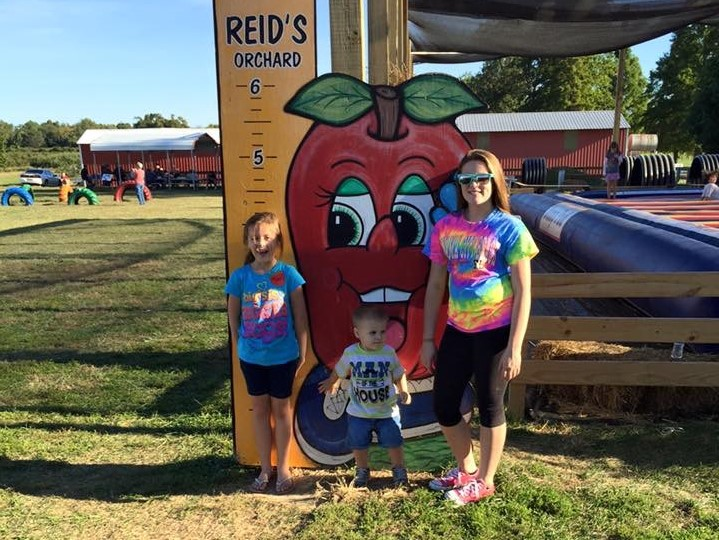 Kylie and family visiting Reid's Orchard in Maceo, KY.