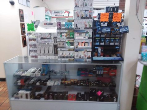 A display stand of various vaping products at a gas station.