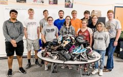 Some of our CHS National Honor Society members pose with the nearly 100 pairs of shoes that our students and community donated to the SCARS Foundation.