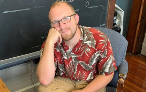 On this Tropical Thursday, Mr. Parr is sporting a deep red shirt with a heavy dose of palms.