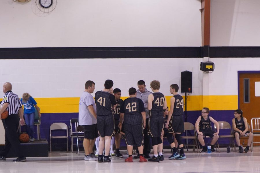 Coach Snyder draws up a game plan for his 8th grade boys team. November 7, 2019.