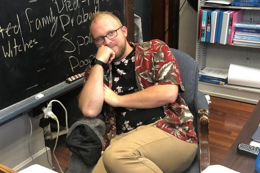 Mr. Parr wears a deep red tropical shirt with a palm leaf print, complimented by a black, flower print t-shirt.