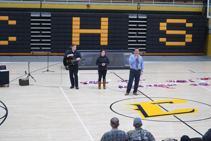 Principal Snyder introduces seniors Isaac Corley and Megan Powers at our annual Veteran's Day Program.