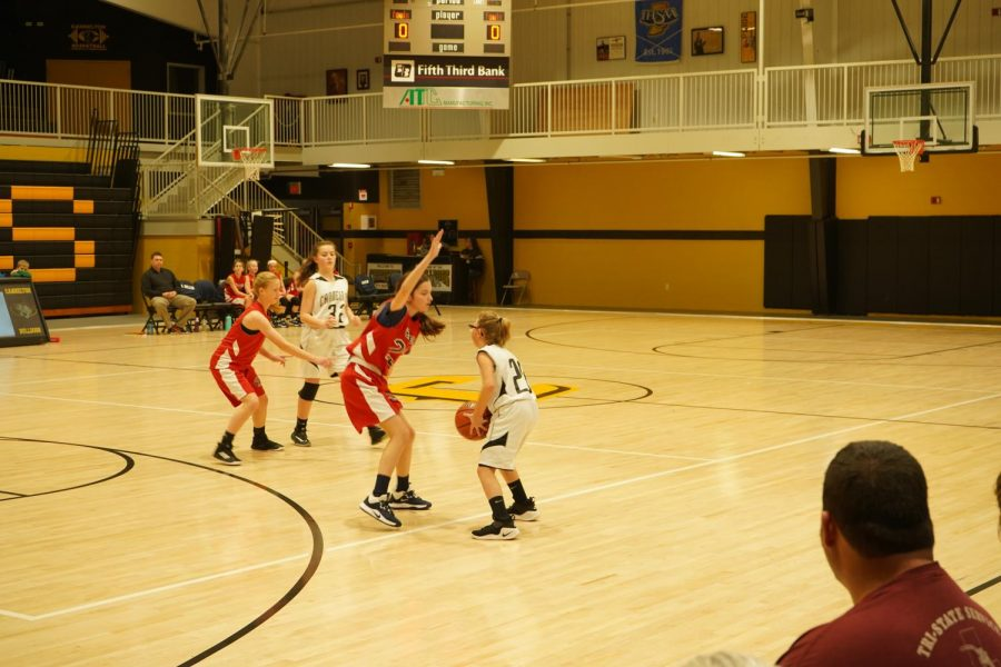 Brianna looking for someone to pass the ball too.