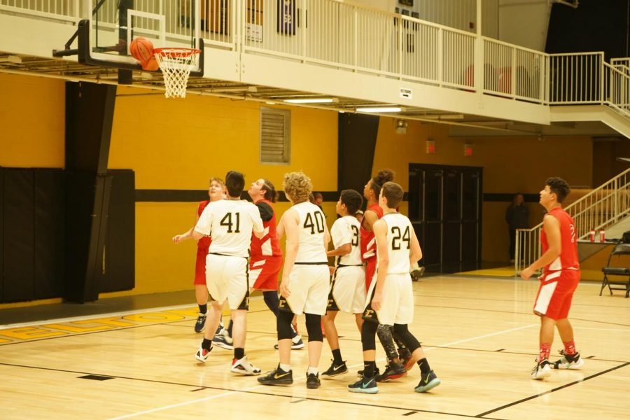 Some+of+the+boys+attempting+to+get+a+rebound.