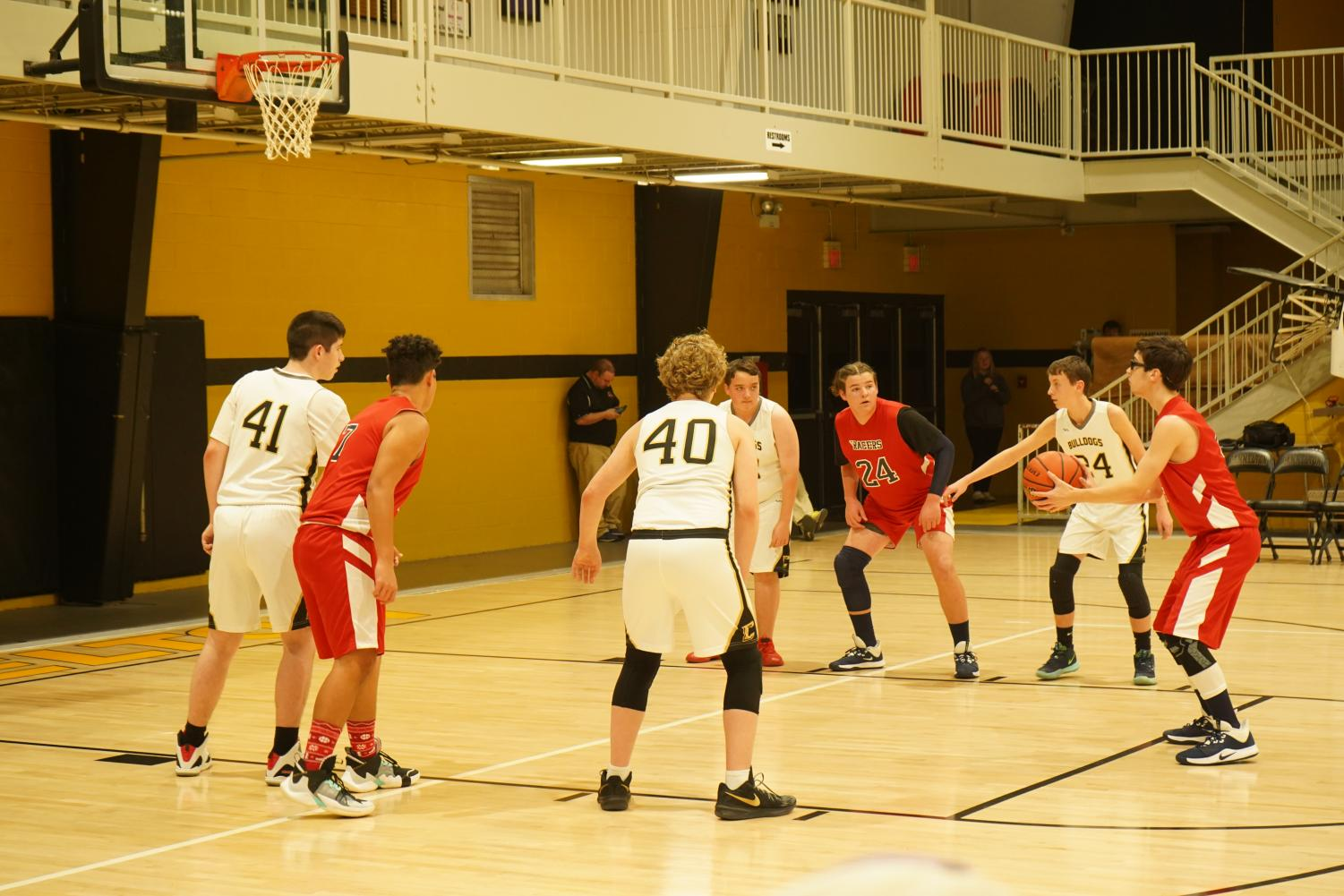 The boys getting ready to block out as opposing teammate shoots.