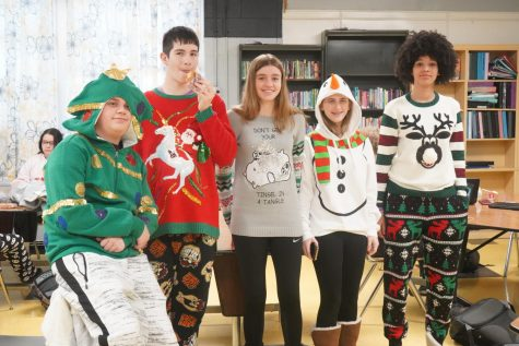 Some of our eighth grade Ugly Holiday Sweater contest entries, including first place winner Carter (far left).