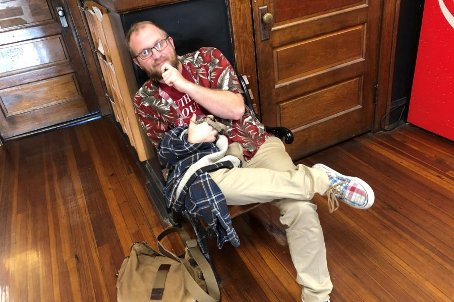 Mr. Parr is totally nailing the pattern-mixing trend - featuring his deep red tropical shirt with a green palm leaf print, and plaid shoes in coordinating colors.