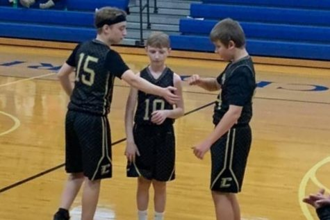 Rylan, Caleb, and Gage get ready to start the game.
