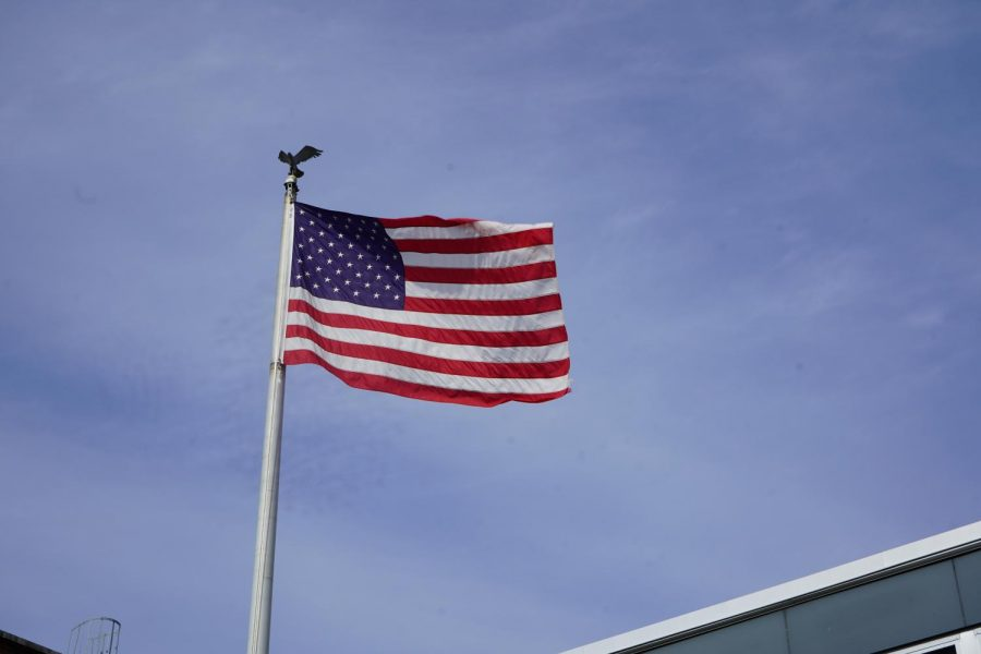 The American Flag located in the front of the high school.