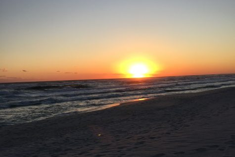 A sun setting over the ocean at Panama City Beach.
