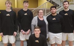 Mrs. Hinton and our senior boys basketball players.