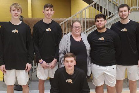 Mrs. Hinton and our senior boys basketball players.