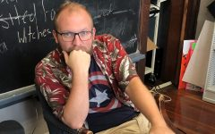 Mr. Parr wearing a red and green tropical shirt, matching the red in Captain America's shield.