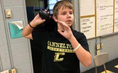 Student Gage Garrett ready to throw the football.