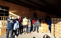 A group of CHS students helped distribute 2,000 boxes of food to help those affected by the COVID-19 pandemic. Friday, October 30, 2020.