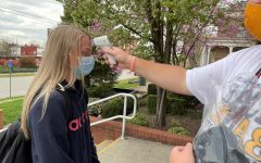 Staff member, Mr. Garrett, takes students temperatures and provides them with masks everyday. The importance of taking temperatures is to ensure students and staff are healthy before attending school.